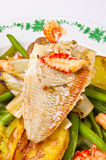 Roasted Dorade with seafood Stock Images