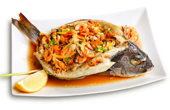 Roasted dorade stuffed with seafood Stock Images