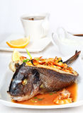 Roasted dorade stuffed with seafood Stock Photography