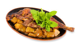 Roasted duck. With potatoes and mint isolated on white background with clipping path Stock Photos