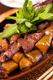 Roasted duck. Delicious roasted duck with potatoes and mint Stock Photos