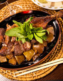 Roasted duck. Delicious roasted duck with potatoes and mint Stock Image