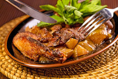 Roasted duck. Delicious roasted duck with potatoes and mint Stock Photography