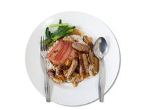 Roasted duck and barbuced red pork on rice (isolated). Thai/Chinese roasted duck and barbuced red pork  and crispy pork in sauce on Jasmine rice with scalded Royalty Free Stock Photos
