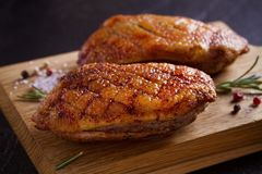 Roasted duck breast on chopping board. Roasted duck breast on chopping board - image royalty free stock photography