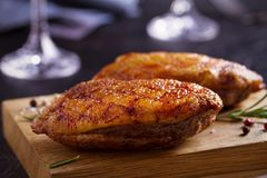Roasted duck breast on chopping board. Roasted duck breast on chopping board - image stock images