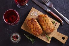 Roasted duck breast on chopping board. Roasted duck breast on chopping board - image, overhead, top royalty free stock photography