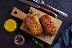 Roasted duck breast on chopping board. Roasted duck breast on chopping board - image, overhead, top royalty free stock photo
