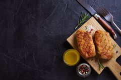 Roasted duck breast on chopping board. Roasted duck breast on chopping board - image, overhead, top, room for text royalty free stock images