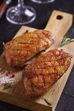 Roasted duck breast on chopping board. Roasted duck breast on chopping board - image royalty free stock images