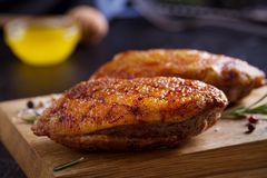 Roasted duck breast on chopping board. Roasted duck breast on chopping board - image stock photography