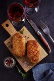 Roasted duck breast on chopping board. Roasted duck breast on chopping board - image, overhead, top stock photos