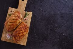 Roasted duck breast on chopping board. Roasted duck breast on chopping board - image, overhead, top, room for text stock images