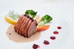 Roasted duck breast with cranberry and cream sauce Royalty Free Stock Images