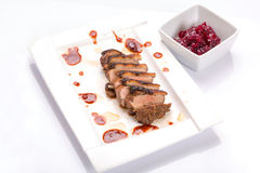 Roasted duck breast with cranberry sauce Stock Photography