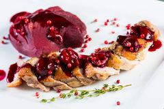 Roasted duck breast with cranberry sauce Royalty Free Stock Image