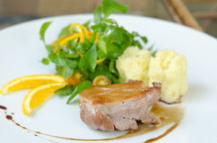 Roasted duck breast on dish Stock Photo