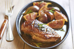 Roasted duck breast with figs and rosemary Stock Photography