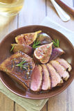 Roasted duck breast with figs and rosemary Royalty Free Stock Images