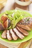 Roasted duck breast with figs and salad Stock Images