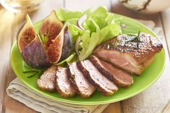 Roasted duck breast with figs and salad Stock Image