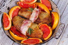 Roasted duck breast fillet with bacon and grapefruit. Royalty Free Stock Image