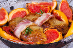 Roasted duck breast fillet with bacon and grapefruit. Royalty Free Stock Photo