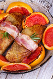 Roasted duck breast fillet with bacon and grapefruit. Stock Image