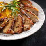 Roasted duck breast with orange and herbs Royalty Free Stock Photos