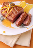 Roasted duck breast with orange sauce Stock Photo
