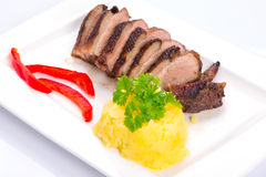 Roasted duck breast with potatoes. And red peppers Stock Photos