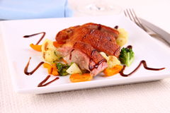 Roasted duck breast, vegetables and cutlery Royalty Free Stock Image