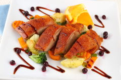 Roasted duck breast, vegetables, wild blueberries Stock Photography