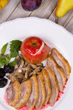 Roasted Duck Breasts with Mushroom, Apple and Plums Stuffing in Red Wine Sause. Stock Image