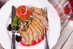 Roasted Duck Breasts with Mushroom, Apple and Plums Stuffing in Red Wine Sause. Royalty Free Stock Photo