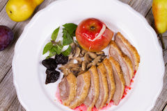 Roasted Duck Breasts with Mushroom, Apple and Plums Stuffing in Red Wine Sause. Royalty Free Stock Image