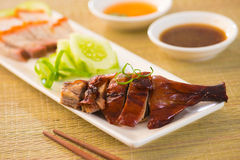 Roasted duck, Chinese style , drumstick and chopstick Royalty Free Stock Photos