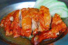 Roasted duck. And cucumber in the plate Royalty Free Stock Photo