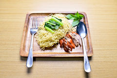 Roasted duck with egg noodle. On wooden plate Stock Photo