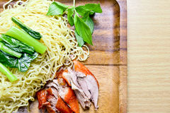 Roasted duck with egg noodle. On wooden plate Royalty Free Stock Images