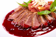 Roasted duck fillet with berry sauce Stock Photos
