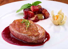 Roasted duck fillet with berry sauce Stock Photo