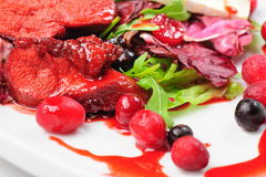 Roasted duck fillet salad with berry sauce Stock Photo