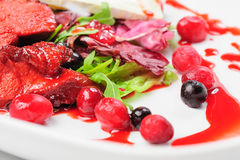 Roasted duck fillet salad with berry sauce Stock Photos