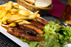 Roasted duck with french fries, potatoes, caramelized, and Salad Royalty Free Stock Photography