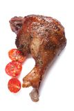 Roasted duck leg and cherry tomatoes isolated on white Stock Images