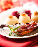 Roasted duck leg for Christmas. Roasted duck leg with potato dumplings and red cabage; German cuisine Royalty Free Stock Photo