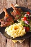 Roasted duck leg with mashed potatoes garnish and salad mix clos Royalty Free Stock Image