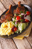 Roasted duck leg with mashed potatoes side dishes, and fresh sal Stock Photography