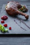 Roasted duck leg, restaurant food closeup Stock Photo